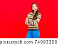 Portrait beautiful young asian woman smile with action on red background 74993399