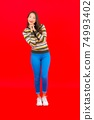 Portrait beautiful young asian woman smile with action on red background 74993402