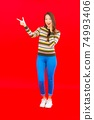 Portrait beautiful young asian woman smile with action on red background 74993406