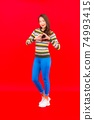 Portrait beautiful young asian woman smile with action on red background 74993415