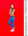 Portrait beautiful young asian woman smile with action on red background 74993419