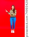 Portrait beautiful young asian woman smile with action on red background 74993420