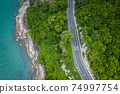 Aerial view of road between coconut palm tree and great ocean at daytime in Nakhon Si Thammarat, Thailand 74997754
