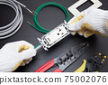 Image of outlet expansion work Ground wire work Grounding work Construction site Electric shop image Electrical work image 75002076