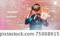 Young girl getting experience VR headset is using augmented reality eyeglasses being in virtual reality. Girl with hands up wearing virtual reality goggles. Woman touching air during VR experience 75008615