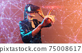 Young girl getting experience VR headset is using augmented reality eyeglasses being in virtual reality. Girl with hands up wearing virtual reality goggles. Woman touching air during VR experience 75008617