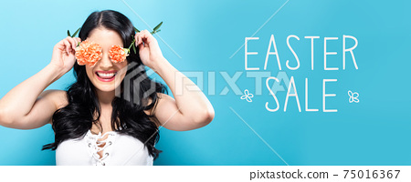 Easter sale message with young woman holding carnations 75016367