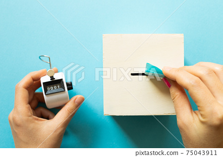 Voting box and tally counter on blue background. top view, copy space 75043911