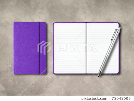 Purple closed and open lined notebooks with a pen on concrete background 75045009