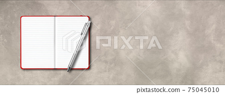 Red open lined notebook with a pen isolated on concrete background. Horizontal banner 75045010