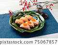 Sushi (salmon, roasted salmon, salmon roe). 75067857