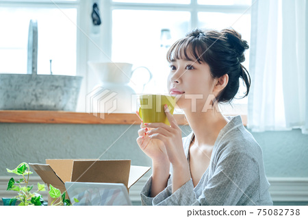 A young woman in pajamas spending her time at home 75082738
