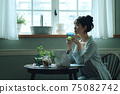 A young woman in pajamas spending her time at home 75082742
