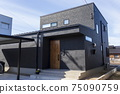 Exterior of new house Black house with one-sided roof 75090759