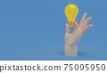 Hand holding yellow light bulb. 75095950