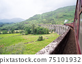 Jacobite Steam Train Locomotive passing Glenfinnan Viaduct 75101932