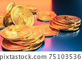 Cryptocurrency Bitcoin golden coins spilling on the table. 75103536