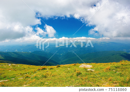 carpathian summer mountain landscape. beautiful countryside with rocks on the grassy hill. view in to the distant valley. clouds on the blue sky. wonderful travel destination 75118860