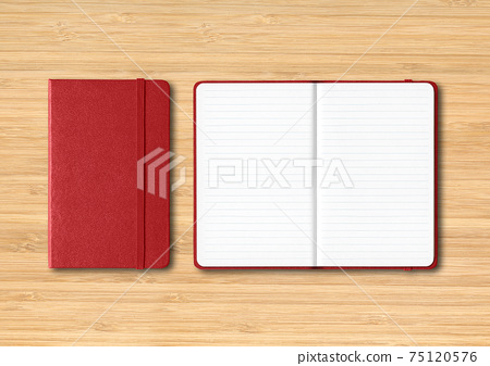 Dark red closed and open lined notebooks on wooden background 75120576