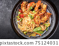 Traditional Thai Phak Kung curry with barbecue king prawns and noodles 75124031