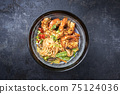 Traditional Thai Phak Kung curry with barbecue king prawns and noodles 75124036