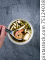 Traditional Japanese miso soup with king prawns and tofu  75124038