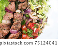 Traditional Greek souvlaki barbecue skewer with cabbage and tomato onion 75124041
