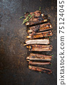 Barbecue spare ribs St Louis style with hot honey chili marinade sliced  75124045