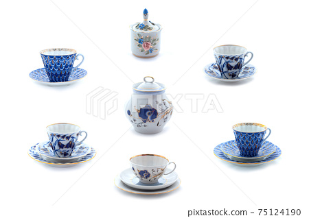Collection of porcelain tea cups and dishes with flower ornament. Full size. 75124190