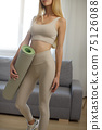 Sporty Woman with Yoga Mat at Home 75126088