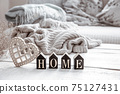 Cozy composition in Scandinavian style with decorative word home and decor details close up. 75127431