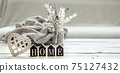 Cozy composition in Scandinavian style with decorative word home and decor details. 75127432