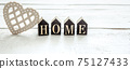 Minimalistic composition with decorative word home and decorative heart close up. 75127433