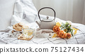 Home composition with tea, teapot, cookies and a bouquet of flowers. 75127434