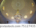 Beautiful ceiling in Islamic, Muslim style with a large chandelier. 75127435