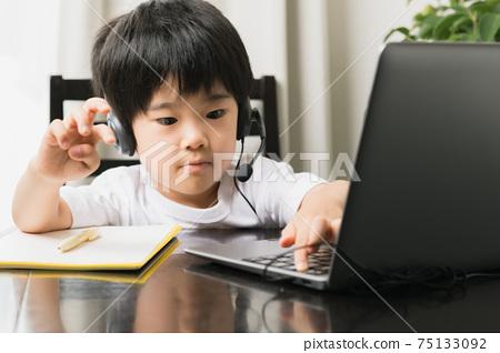 Boy taking online classes 75133092