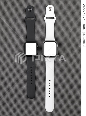 Smart watch with a blank white screen on a gray background. 75173342
