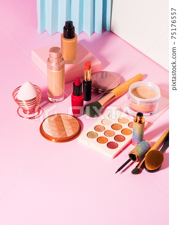 Different make up beauty cosmetics products on pink 75176557