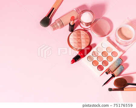 Different make up beauty cosmetics products on pink 75176559