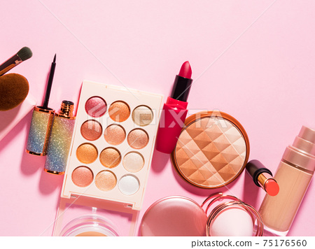 Different make up beauty cosmetics products on pink 75176560