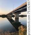 River and elevated road illuminated by the setting sun (Yodogawa Shinbashi) 75182807