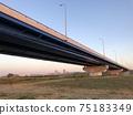 A large bridge over the riverbed at dusk (Yodogawa Shinbashi) 75183349