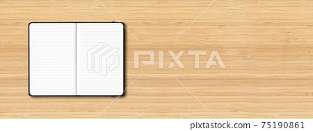 Black open lined notebook isolated on wooden background. Horizontal banner 75190861