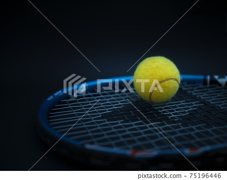 Sport and healthy lifestyle. Tennis. Yellow ball for tennis and a racket on table. Sports background with tennis concept 75196446