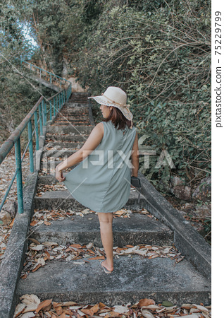 Beautiful woman walking on the staircase  75229799