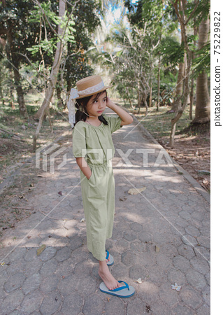 little girl in dress standing and posing 75229822