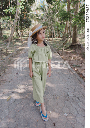 little girl in dress standing and posing 75229987