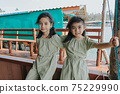 Portrait of Two little girls in beautiful dresses 75229990