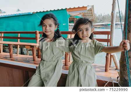 Portrait of Two little girls in beautiful dresses 75229990