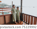 Portrait of Two little girls in beautiful dresses 75229992